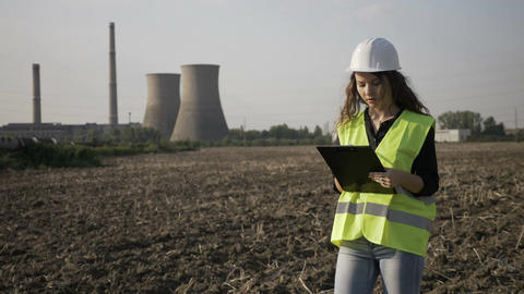 Young engineer woman in charge with work safety inspecting on site construction Live Action