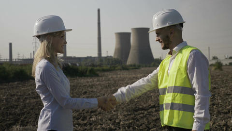 Man and woman developers shaking hands after a successful engineering project Footage