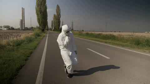 Contaminated ecologist worker in hazmat suit chocking and falling down on drive Footage
