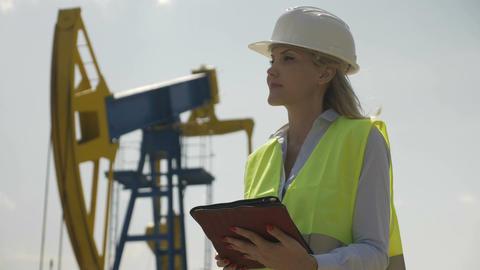 Portrait of engineering female coordinator supervising petroleum installation Footage