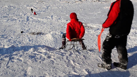 Children who are sledding down a slippery slope and snowy 3 Footage