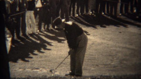 1938: Professional Golfer Ralph Guldahl Chip Shot With Crowd Surrounded stock footage