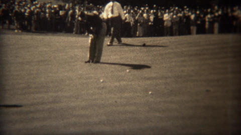 1938: Professional golfers putting on 18th green in golf tournament Footage