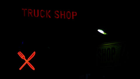 Lighting Advertisement To A Restaurant And A Truck Accessories Shop stock footage