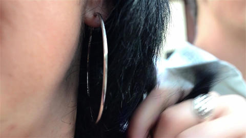 Woman playing with her black hair curls Live Action