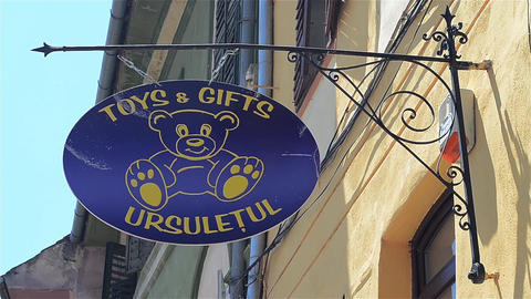 Toys and gifts commercial advertising on the wall of a shop Footage