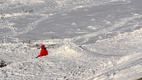 Children who are sledding down a slippery slope and snowy 7 Footage
