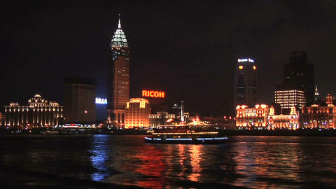 Sightseeing Boat on the Huang Pu River with the well lit Bund in Background at N Live Action
