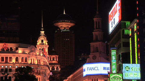 Well lit Buildings and Neon Signs on Nanjing Road East Live Action