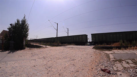 Freight train passing over a facility for passing cars over the railway equipped Footage