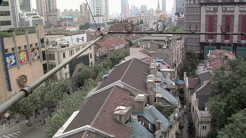 Over the Rooftops of Buildings behind Nanjing Road West, looking North Live Action