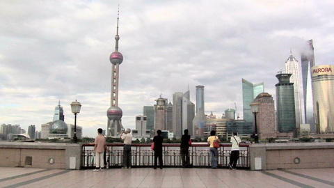 Skyline of Pudong with the Oriental Pearl TV Tower and the Huangpu River and Tou Live Action