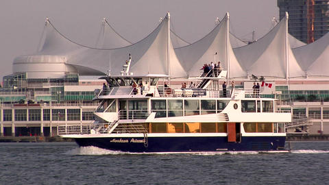 Sightseeing Boat passes the Canada Place Live Action