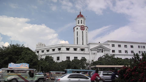 Traffic passing by Manila Cityhall, Philippines Footage