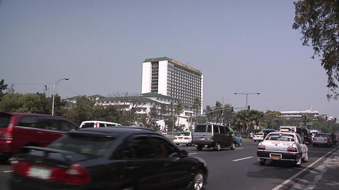 Traffic on Roxas Boulevard and the Manila Hotel in the Background Live Action
