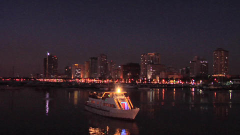 A Sightseeing boat leaves for a Sunset Cruise of Manila Bay, Philippines Footage
