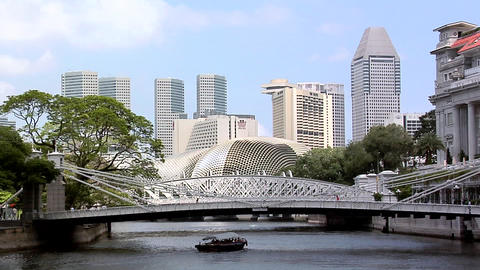 Singapore River with Tourist Boats and the Cavenagh Bridge and the Skyline of Ma Footage