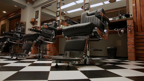the camera on the Steadicam shows the interior of a Barber shop with a beautiful Footage