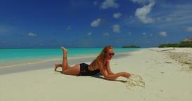 v09992 beautiful young girl in bikini sunbathing and relaxing by the aqua blue Live Action