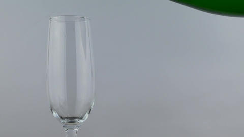 Champagne pour into glass over isolate white background Footage