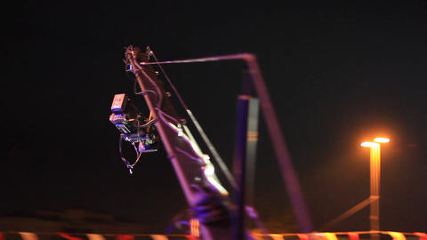 Jimmy Jib Crane Camera in action at night concert. Jimmy... Stock Video Footage
