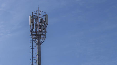 Phone telecommunications tower time. cellular network data transmission and TV Footage