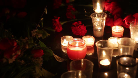 Memorial, flowers and candles in memory of those killed... Stock Video Footage