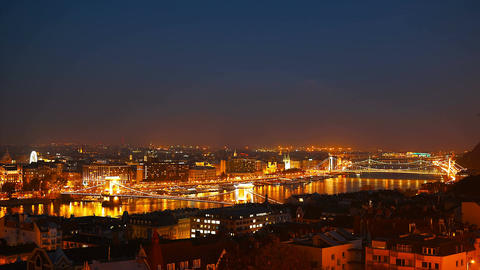 Night time-lapse. Budapest with the Danube and Chain Bridge, Hungary. Aerial Footage