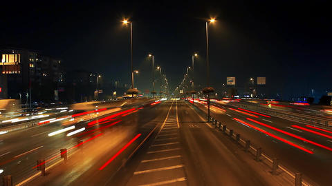 Night car traffic light streaks and street lights on highway Footage