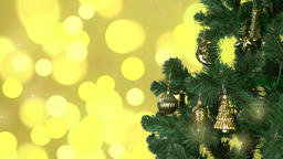Green christmas tree rotate with gold decor on branches. Flickering gold Footage