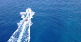 v09366 People enjoying boats and watersports with view from aerial flying drone Footage