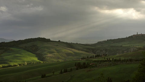Ray of the setting sun slips over hills of Tuscany Footage