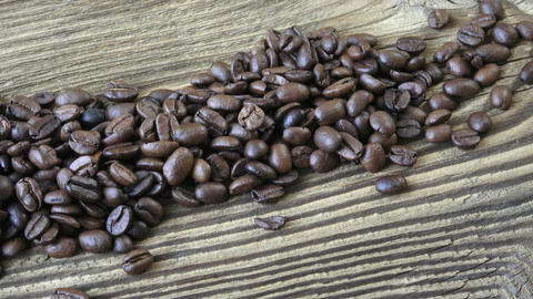 Raw coffee beans. Coffee beans on wood background Live Action