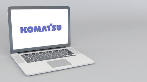 Opening and closing laptop with Komatsu Limited logo. 4K editorial animation Live Action