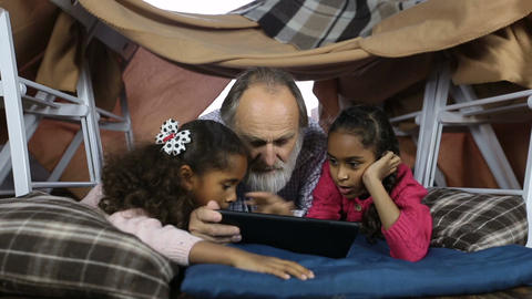 Clever kids showimg grandpa how to use touchpad Footage