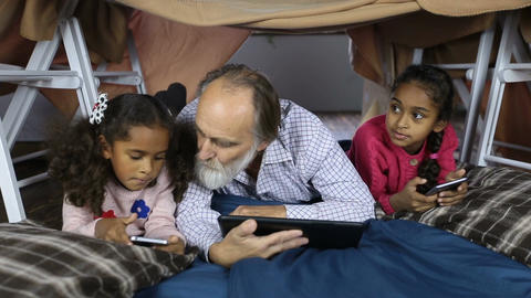 Multi-ethnic family using technology gadgets Live Action