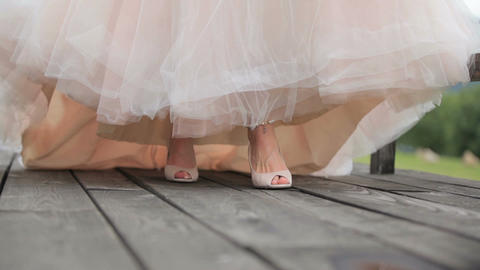 bride in sandals and in long chic dress. Georgia 스톡 비디오 클립, 영상 소스, 스톡 4K 영상
