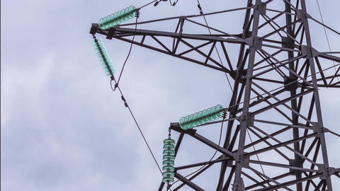 High-voltage power lines. The metal construction keeps the wires. Power Live Action