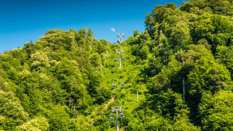 Ski lifts against the sky and the moon time lapse Filmmaterial
