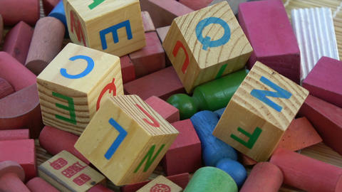 Rotating alphabetical and other toy wooden cubes ビデオ