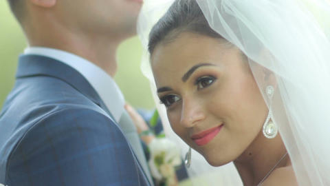 beautiful newlyweds gently embrace. young couple in love . wedding day. groom Live Action