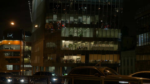 People work in the business center. View from the street through the storefronts Footage