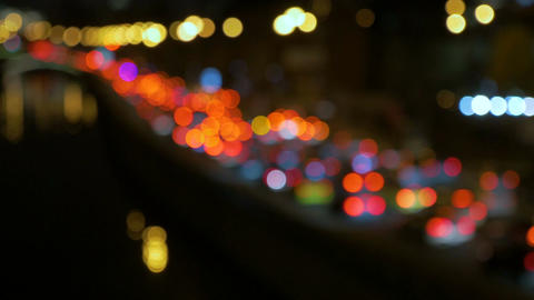 Abstract lights of traffic in the night. Blurred, not in focus, intentionally Footage