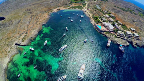 Boats in the sea . Aerial view. Malta Live Action