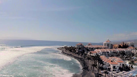 Luxury hotels and pools on the blue sea and mountains. Tenerife. Aerial view Footage