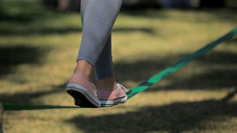 Girl is walking on rope Live Action