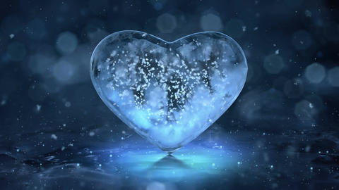 Rotating Blue Ice Glass Heart with snowflakes inside motion background Loop 4K Animation