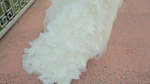 Wedding day. Bride in white chic dress. Back view GIF