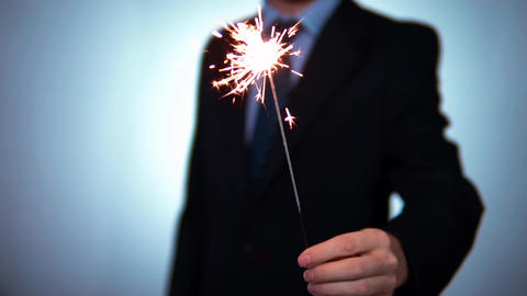 Sparkler businessman holds in hands. Christmas holidays, New Year, corporate Footage