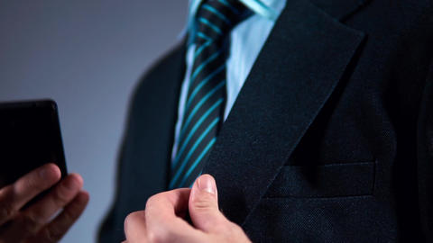 slow motion, businessman pulls the phone out of his jacket pocket Footage